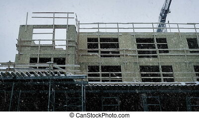 Large Building Under Construction In Snowfall - Building...
