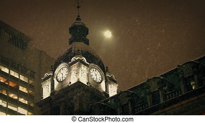 Clock Tower Building In Snowstorm - Large old clock tower...