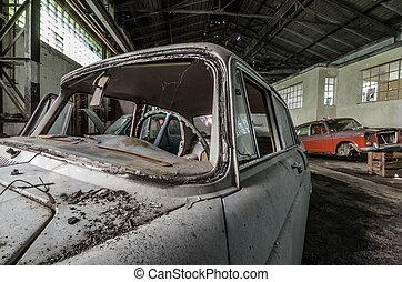 old broken car in hall - old broken car in a big hall