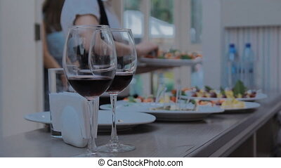 Two Glasses with Red Wine - Footage of stylish wine glasses...
