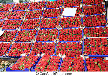 many boxes with red ripe strawberries - grocery shop with so...