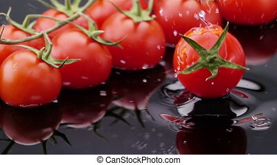 Ripe Tomato Falls on the Table. - Ripe Tomato Falls on the...