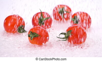 A Several Ripe Tomatoes are Falling on the Table.