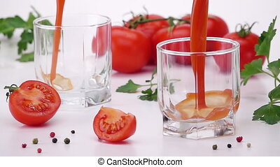 Pouring Tomato Juice Into Glass. Light Background. Slow...