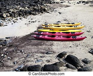 Five Kayaks On The Beach