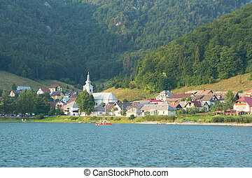 small village with lake and forest