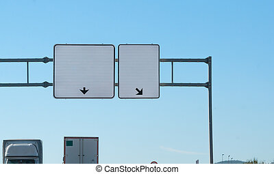 Two blank highway signs overhead. Trucks on road. Transport...