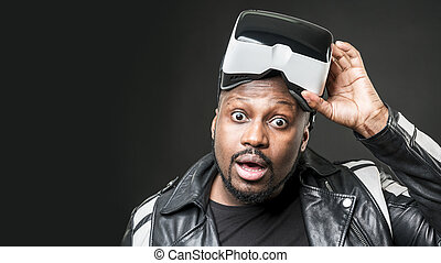 Young man wearing virtual reality googles / VR Glasses -...