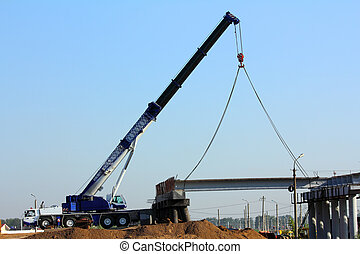 crane on the construction of overpass - large automobile...