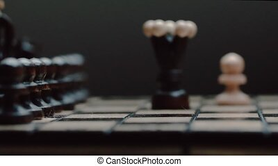 Chess pieces white pawn queen attacks. chess closeup, wooden...