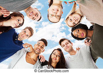 Confident College Students Forming Huddle - Low angle...