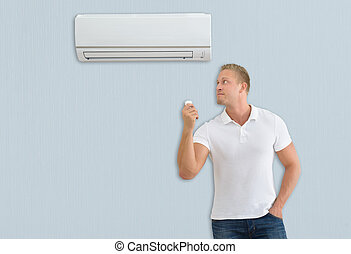 Man With Air Conditioner Remote Control