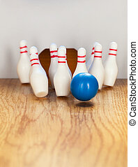 Bowling pins and bowling ball in miniature.
