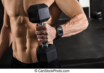 An Athlete Man Holding Dumbbell - Close-up Of A Athlete Man...