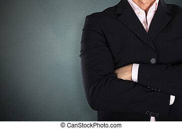 Businessman Standing Arm Crossed - Close-up Of A Businessman...