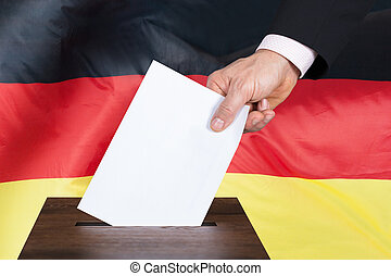 Person Putting Vote In A Ballot Box - Close-up Of A Person...