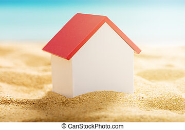 House Model On Beach - Close-up Of A House Model On Sandy...