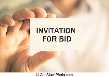 Businessman holding INVITATION FOR BID message card -...
