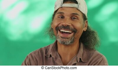 9 Happy People Portrait Of Hispanic Man With Goatee Laughing...