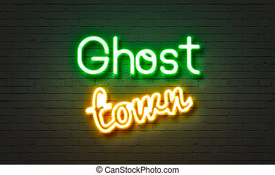 Ghost town neon sign on brick wall background. - Ghost town...