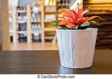 Artificial flower pot.