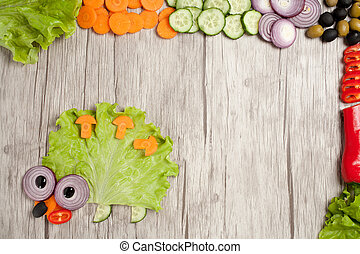 Hedgehog made of fresh vegetables on table with ingredients