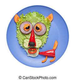 Tired wolf made of vegetables on blue plate