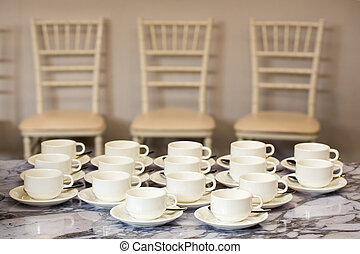 Coffee mugs on a table at a party.