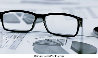 Business background with graphics and glasses