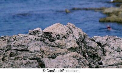 Maltese rock landscape with diver on background 1