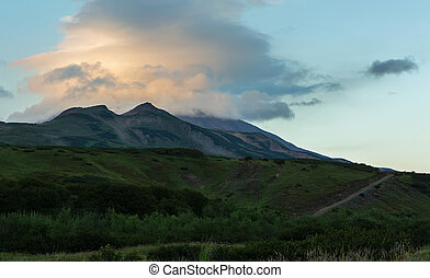 Lenticular clouds above Vilyuchinsky stratovolcano at dawn....