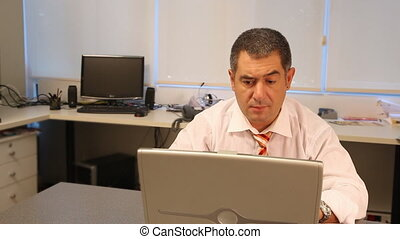 Successful businessman using laptop