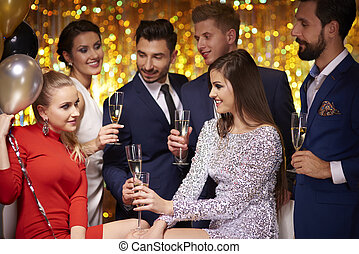 Friends partying together at new years eve