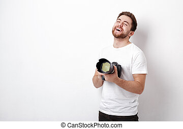 young smilling professional photographer in t-shirt use...
