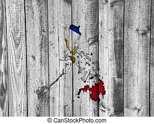 Map and flag of the Philippines on weathered wood