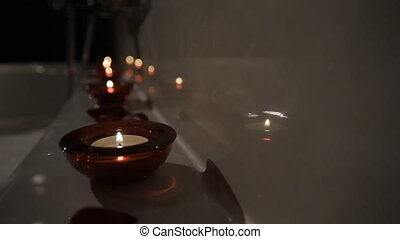Aromatic Candle Lights - Fragrant candle lit in the spa...
