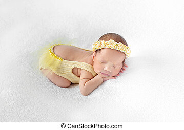 Baby dressed in a yellow outfit sleeping - Lovely baby...
