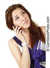 Young beautiful woman dialing