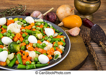 Vegetarian Food: mix of stewed vegetables with mozzarella...