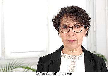 portrait of brunette mature woman with glasses - portrait of...
