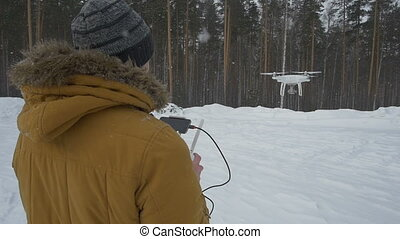 Man launches into the sky quadrocopter - The man with the...