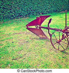 Agricultural Machines - Old Agricultural Machine on a Green...