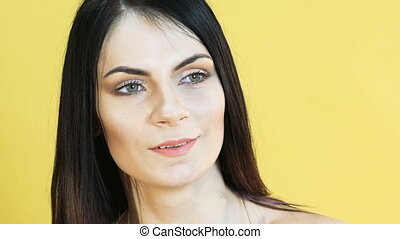 Cute woman with emotion of surprising on yellow background....