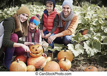 Family preparing for Halloween par