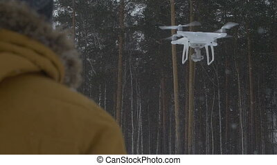 Quadrocopters in the sky - The man with the help of radio...