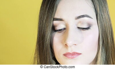 The girl crying to camera on yellow background. Slowly