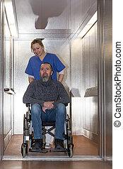 nurse is shoving a patient - nurse is shoving a male patient...