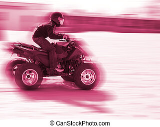 Quad - Close-up of a man driveing a quad