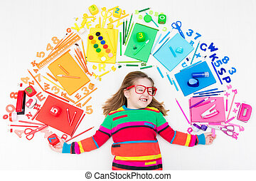 Child with school and drawing supplies. Student with book. -...
