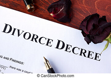 Divorce decree form and faded rose.